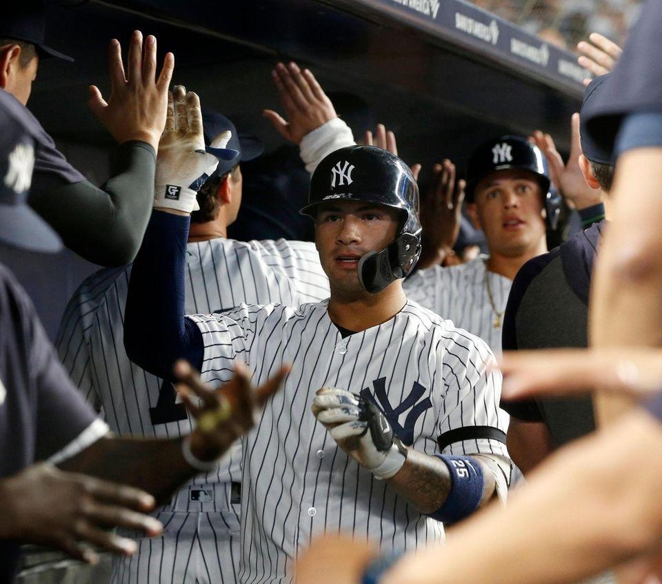 The Yankees' Gleyber Torres celebrates his fifth-inning three-run