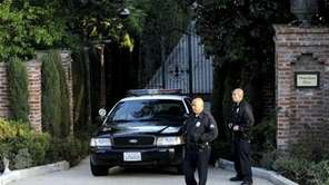 Los Angeles Police Department officers stand guard out