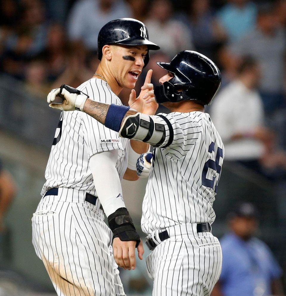 The Yankees' Gleyber Torres celebrates his sixth-inning three