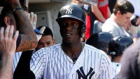 Yankees outfielder Cameron Maybin celebrates his sixth-inning home