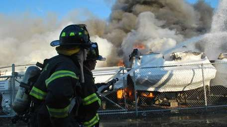 Firefighters work to put out a blaze Wednesday