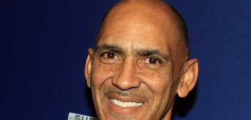 NBC studio analyst Tony Dungy looks on during