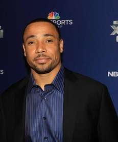 NBC studio analyst Rodney Harrison looks on during