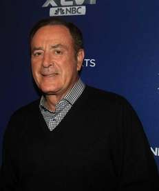 NBC play-by-play commentator Al Michaels looks on during