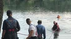 Emergency personnel at Hempstead Lake State Park pond