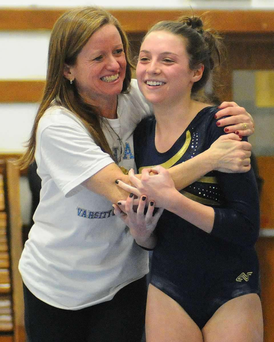 Jamie Kaletcher of Bethpage High School, right, gets