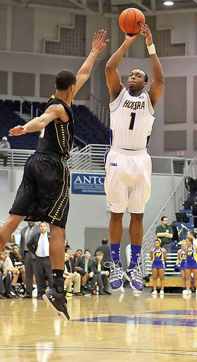 Hofstra's Nathaniel Lester hits a three-pointer during the