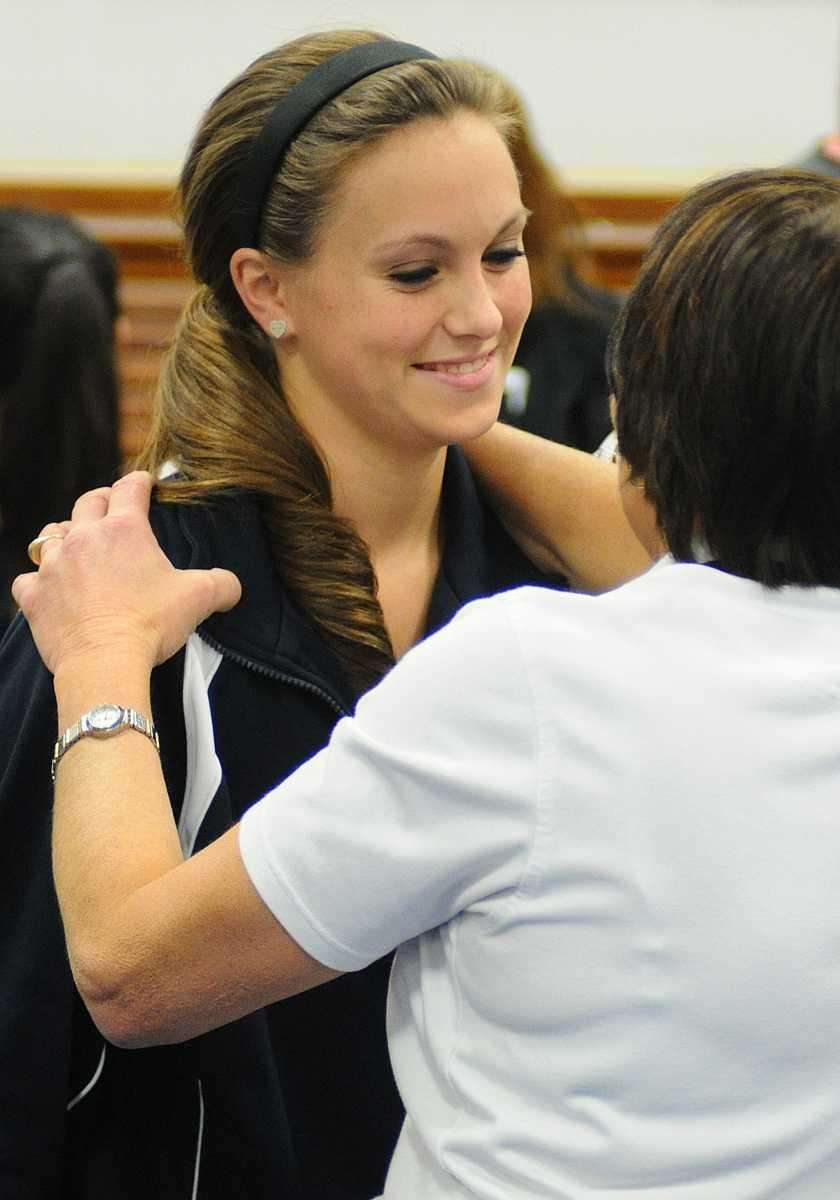 Bethpage High School senior Erin Roach, left, embraces