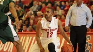 Stony Brook guard Marcus Rouse controls the ball