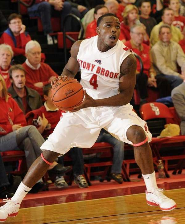 Stony Brook guard Anthony Jackson looks to pass