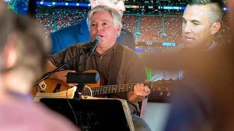 Singer Ricky Roche performs at Jetty Bar &