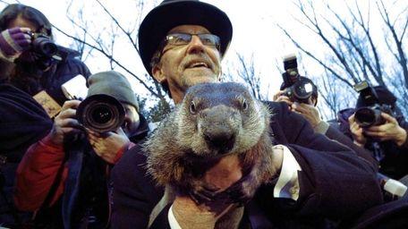 Groundhog Club handler Ron Ploucha holds Punxsutawney Phil,