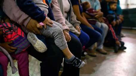 Recently detained migrants, many of them family units,