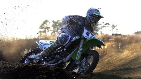 Ben Rio, of Brentwood, works on his motocross
