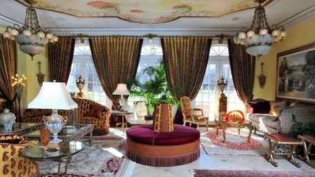 Despite the heavy ornate details, the living room