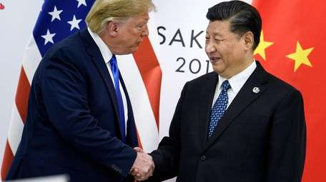 Trump with Chinese President Xi Jinping in June