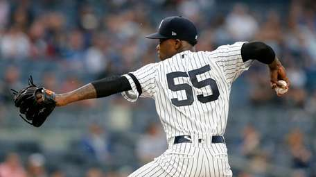Domingo German #55 of the Yankees pitches during
