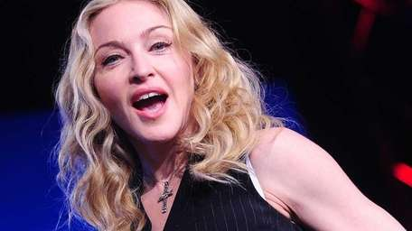 Madonna speaks to the media during a news