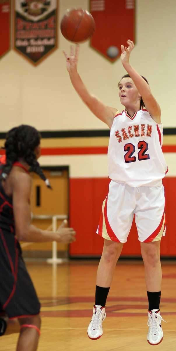 Sachem East guard Meagan Doherty launches a three-point