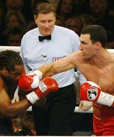 Wladimir Klitschko of Ukraine, right, punches title defender
