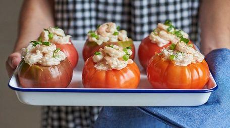 Chilled shrimp salad served inside a ripe tomato