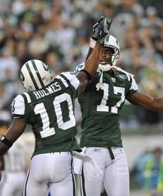Jets receivers Plaxico Burress, right, and Santonio Holmes,