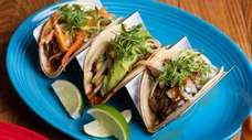 A trio of tacos, from left to right:
