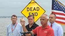 Gregg Rivara holds up oyster shells on Wednesday