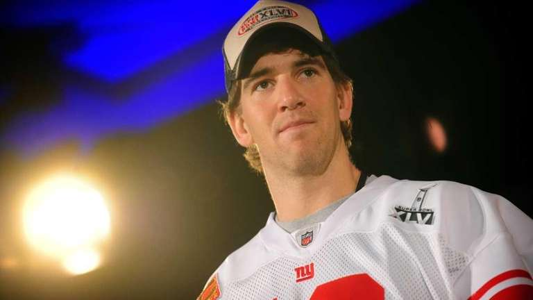 Eli Manning speaks with the media at their