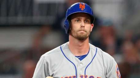 The Mets' Jeff McNeil reacts after striking out