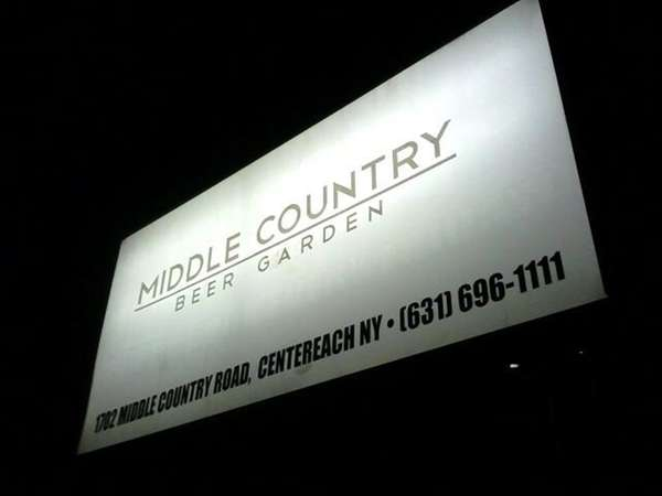 A sign outside Middle Country Beer Garden in