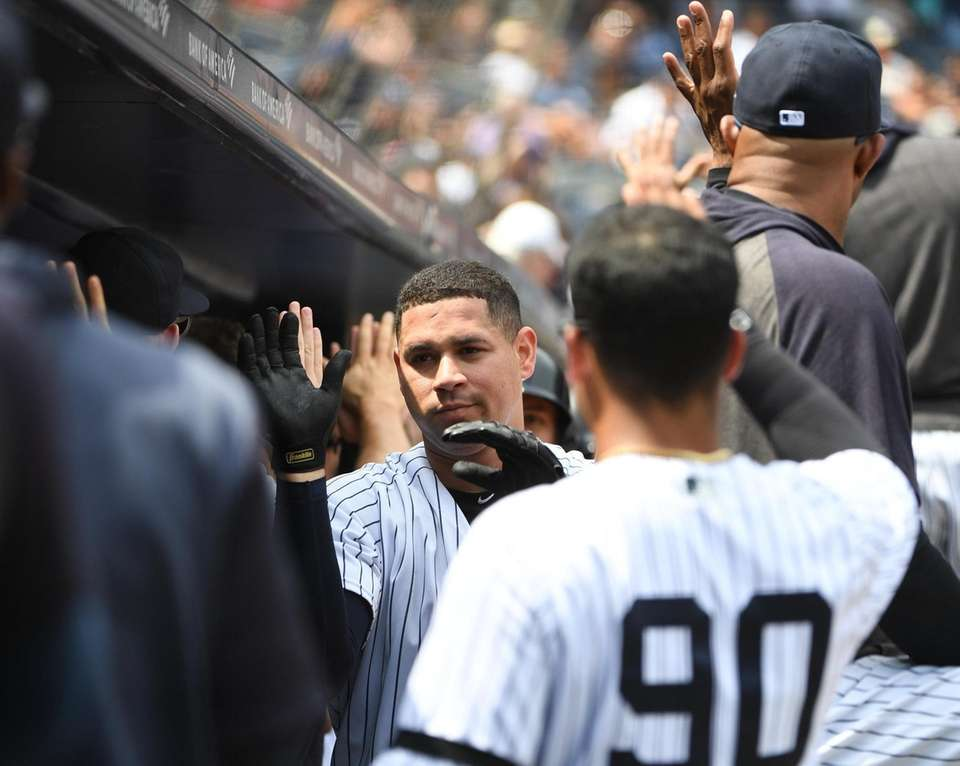 New York Yankees catcher Gary Sanchez is greeted