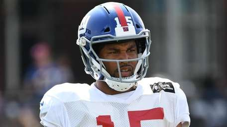 Giants wide receiver Golden Tate looks on during