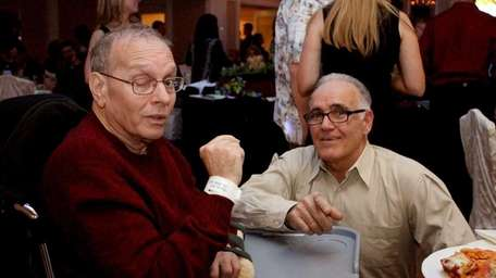 Joel Barish, 64, left, speaks to longtime friend