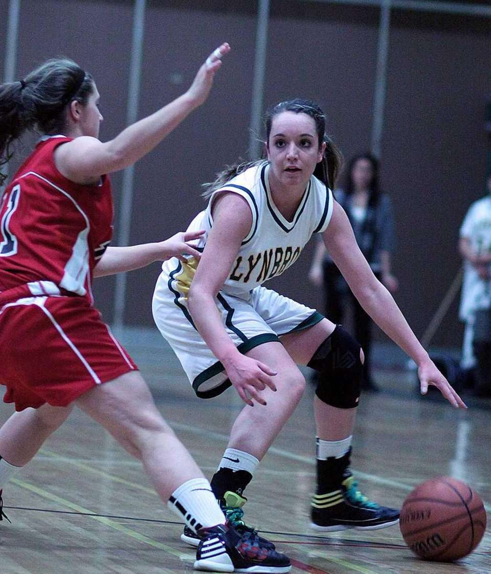 Lynbrook's Shannon Baker gets covered by Floral Park's