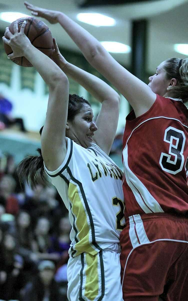 Lynbrook's Danielle Amayaa is closely defended by Floral