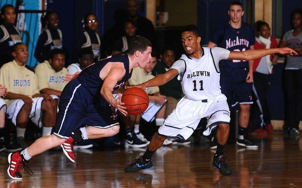 Baldwin's Brandon Williams, right, pressures MacArthur guard Tyler