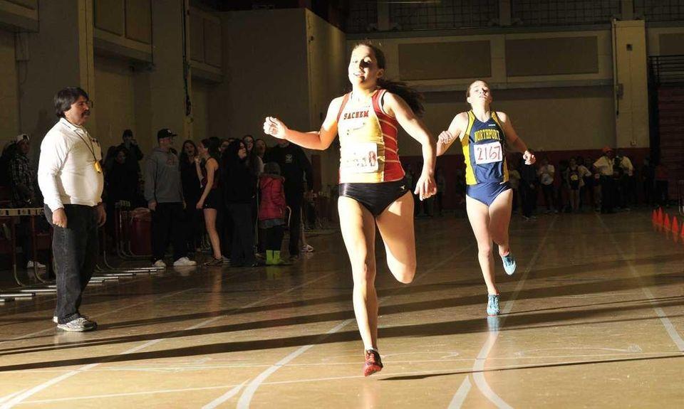 Rachel Paul of Sachem East, left, beats Northport's
