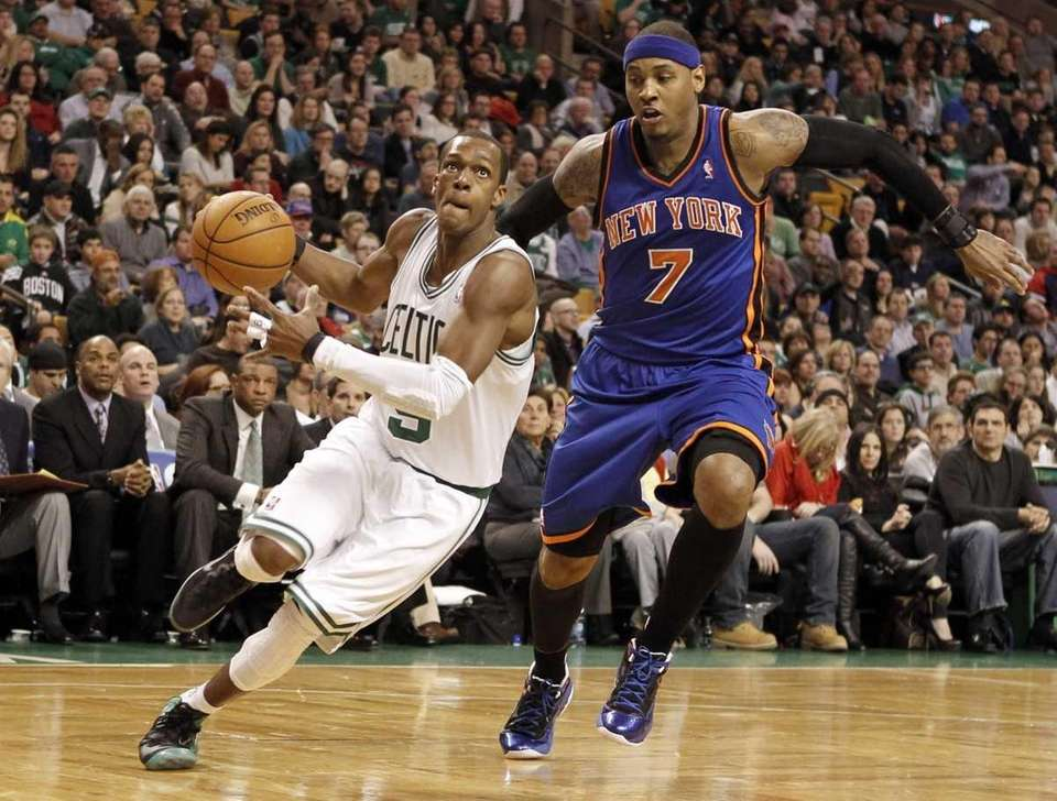 Boston Celtics point guard Rajon Rondo drives past
