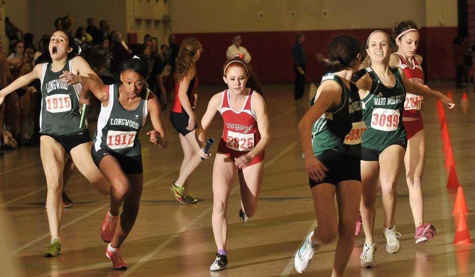 Runners pass the baton in the 4x200 meter