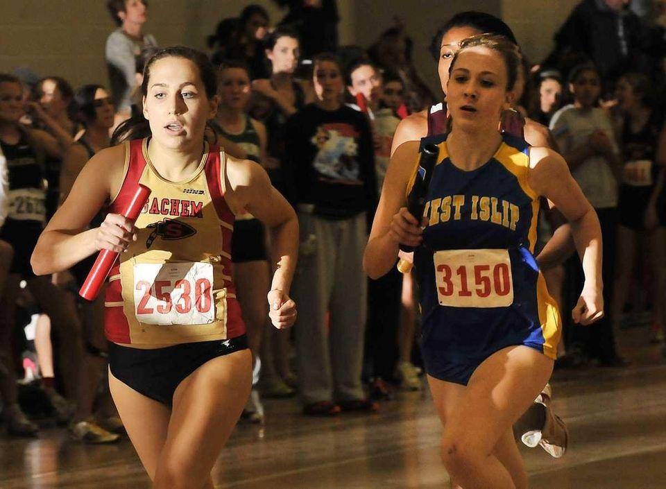 Sachem East's Rachel Paul, left, sprints with the
