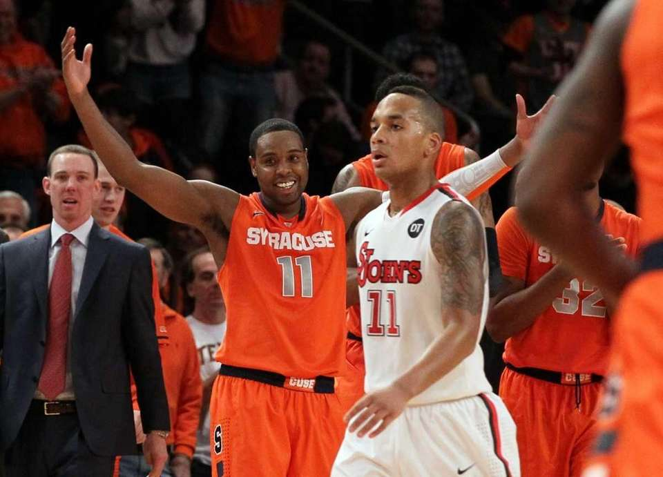Scoop Jardine of the Syracuse Orange celebrates during