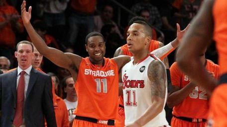 Scoop Jardine of the Syracuse Orange celebrates during