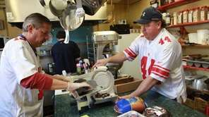 Jim Leonard, left, slices cold cuts at his