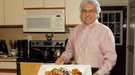 Paul Mendola of Holbrook presents a dish of