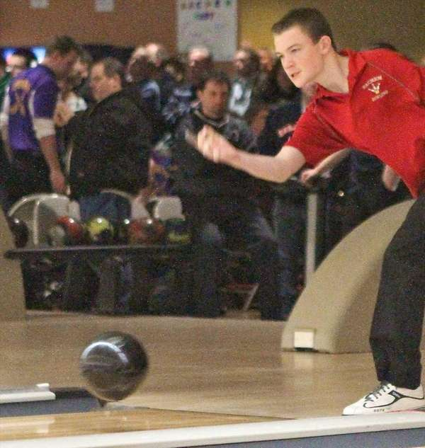 Sachem East's Nick Caruana bowls in the Suffolk