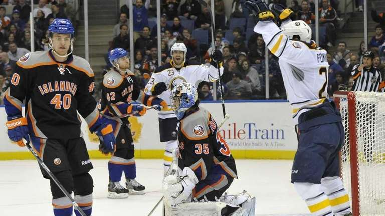 Buffalo Sabres' Ville Leino and Jason Pominville celebrate