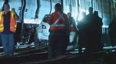 Authorities respond after an LIRR train struck a