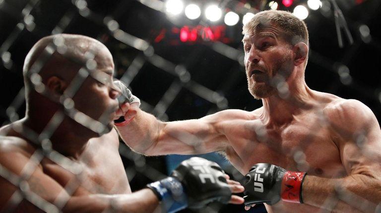 Stipe Miocic, right, fights Daniel Cormier in a