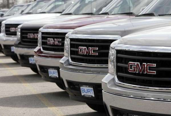 A long row of unsold 2007 Sierra pickup